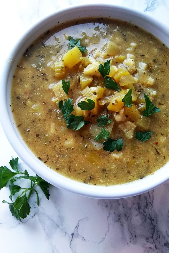 Bowl of the best Vegan Fish Chowder. Golden and rich in flavors.